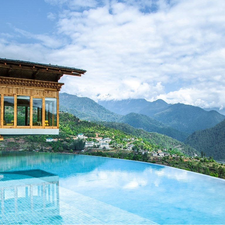 Punakha-Bhutan-Flying_Farmhouse_and_pool_horizontal.jpg